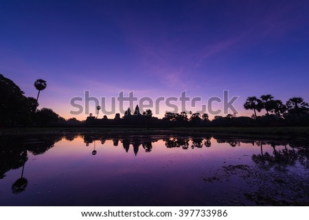 Reflection of Angkor Wat in Cambodia at dawn. - stock photo