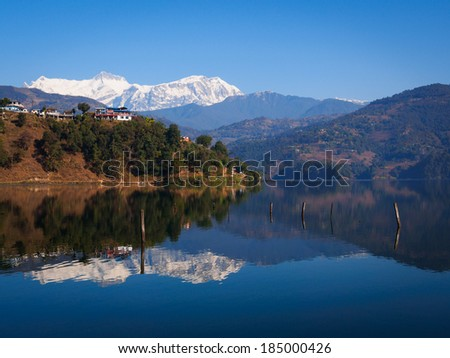 Reflection of Annapurna in Begnas Tal, Nepal - stock photo