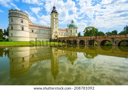 Reflection of beautiful Krasiczyn castle in a lake on a sunny summer day, Poland