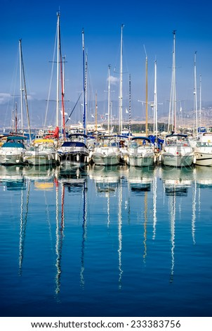 Reflection of boats with masts in port near Polis city, Cyprus. - stock photo