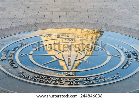 Reflection of Capitol dome over the symbolic compass on the ground. - Washington DC, United States  - stock photo