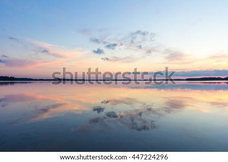 Reflection of clouds in a lake at sunset in Saadjarv in Estonia. - stock photo