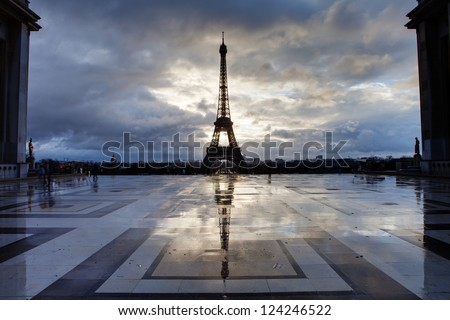 Reflection of Eiffel Tower from Paris with clouds - stock photo