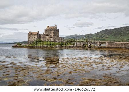 Reflection of Eilean Donan Castle, Highland Scotland - stock photo