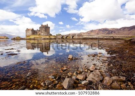 Reflection of Eilean Donan Castle, Highland Scotland UK - stock photo