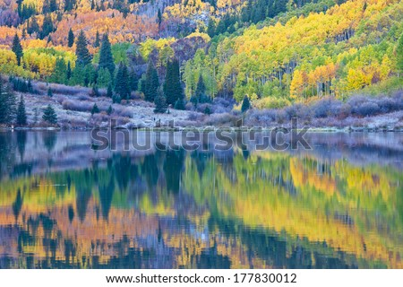 Reflection of fall foliage at Maroon Bells, Aspen, Colorado - stock photo