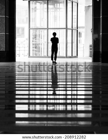 reflection of girl stand alone - stock photo