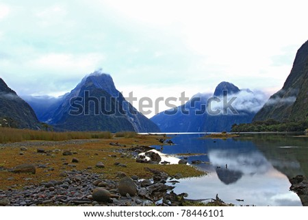 reflection of high mountain glacier at milford sound fiordland of New Zealand