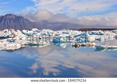 Reflection of Jokulsarlon Lagoon, Iceland  - stock photo