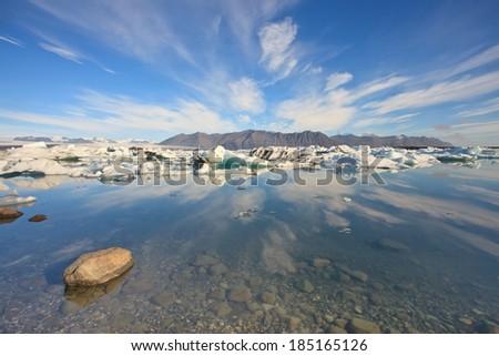 Reflection of Jokulsarlon Lagoon - the famous ice lake in  Iceland  - stock photo