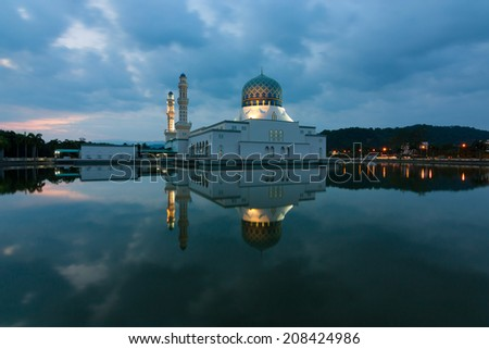 Reflection of Kota Kinabalu city mosque at dawn in Sabah, Malaysia, Borneo - stock photo