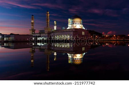 Reflection of Kota Kinabalu mosque at dawn in Sabah, East Malaysia, Borneo - stock photo
