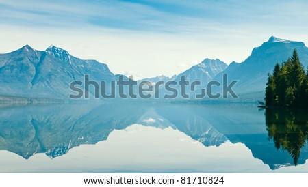 Reflection of Lake McDonald, Glacier National Park, Montana, US - stock photo