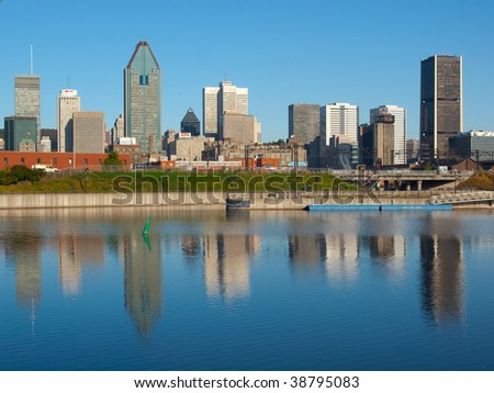 Reflection of Montreal skyline into the Lachine Canal - stock photo