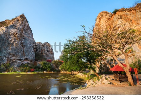 Reflection of Mountain Rock in the swamp - stock photo