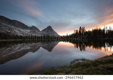 Reflection of mountains in water at sunset,Young Lakes, Yosemite National Park wilderness, California - stock photo