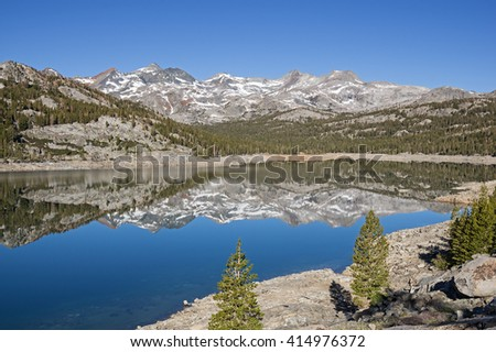 reflection of mountains in Waugh Lake with a low water level because of the California drought - stock photo