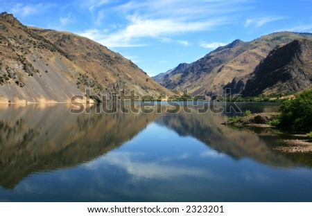 Reflection of mountains on the water,in Hells Canyon,Idaho - stock photo