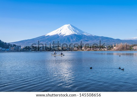 Reflection of Mt Fuji at lake Kawaguchiko - stock photo