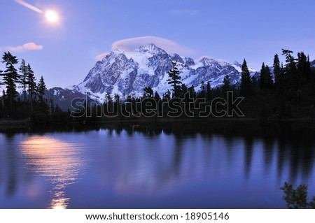 Reflection of Mt Shuksan on Picture Lake at Mount Baker - stock photo