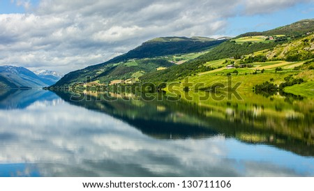 Reflection of Norway - stock photo