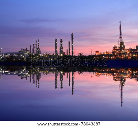 Reflection of petrochemical industry on sunset colorful sky - stock photo