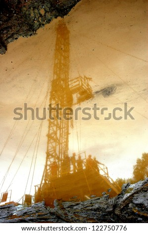 reflection of petroleum miners in the mining area