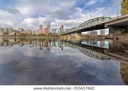 Reflection of Portland Oregon downtown city skyline by Hawthorne Bridge on Willamette River daytime - stock photo