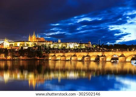 Reflection of Prague caste and the Charles bridge at dusk,Czech Republic - stock photo