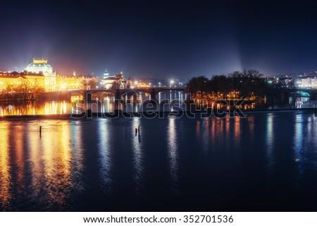 Reflection of Prague caste and the Charles bridge at dusk. Czech republic - stock photo