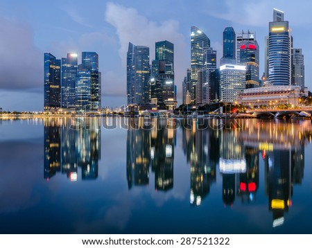 Reflection of Singapore city, Marina bay point of view - stock photo