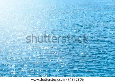 Reflection of sunlight on the blue surface of the sea.