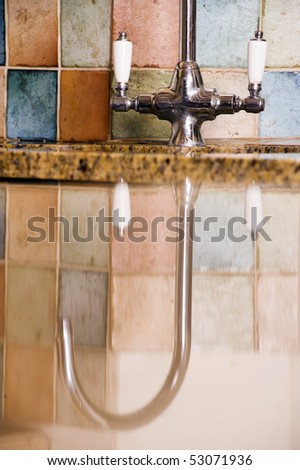 Reflection of Tap In Modern Kitchen - stock photo