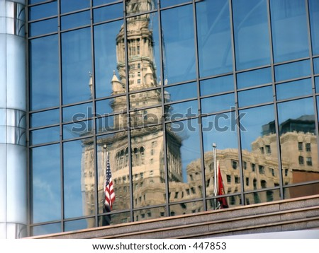 Reflection of Terminal Tower in glass wall—Cleveland, OH - stock photo