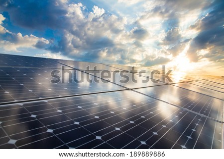 Reflection of the dramatic sky on the photovoltaic modules - stock photo