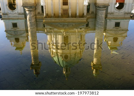 Reflection of the Karlskirche in the pond in front of the church. - stock photo