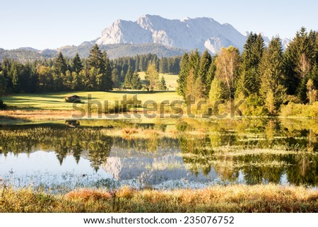 Reflection of the Karwendel Mountains in Lake Tennsee. - stock photo