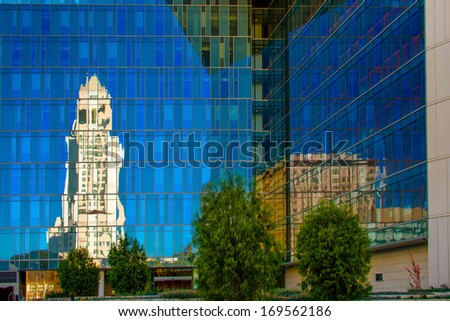 Reflection of the Los Angeles City Hall at Los Angeles Police Dept Headquarters, Los Angeles, California, USA - stock photo