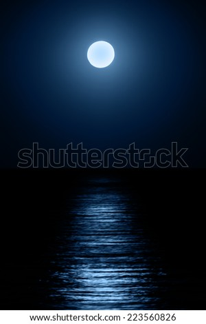 Reflection of the moon on the sea surface. Moonlight path. - stock photo