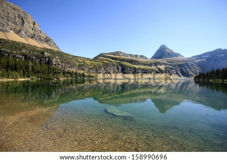 Reflection of the Mountains in Hidden Lake, Glacier National Park, Montana - stock photo