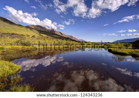 Reflection of the mountains on the lagoon at Glenorchy, New Zealand.