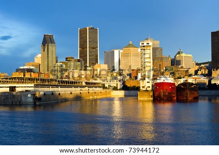 Reflection of the sun at daybreak, on part of the port and city of Montreal. - stock photo