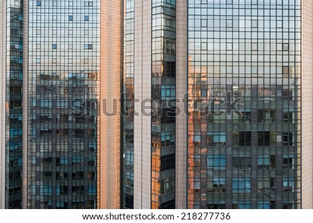 reflection of the sunset on the glass wall - stock photo