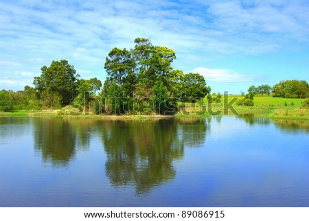 Reflection of trees and lush vegetation on a beautiful lake in victoria australia - stock photo