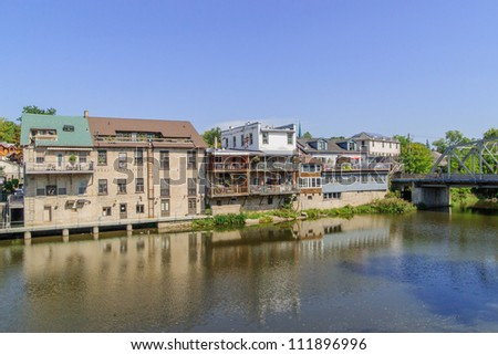 reflection of village in river - stock photo