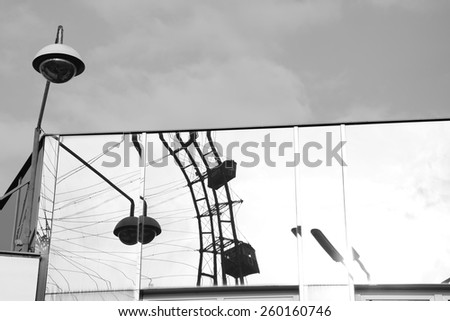 Reflection on glass,fun park. - stock photo