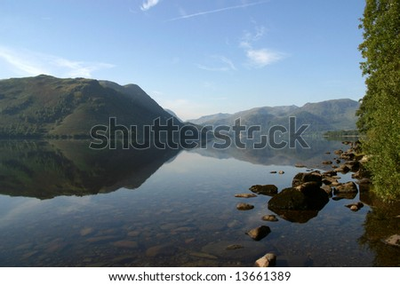 Reflection on Ullswater in the Lake District, Cumbria (England) - stock photo