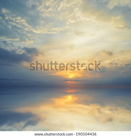 Reflection sky in water, majestic clouds in the sky  - stock photo