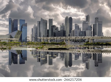 Reflections and clouds at marina bay, Singapore - stock photo