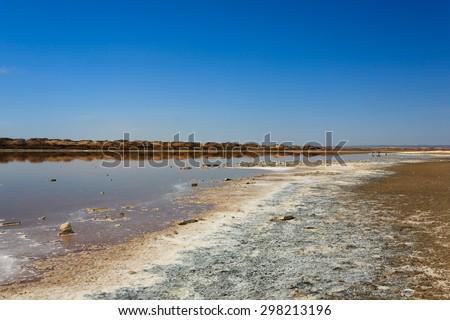 Reflections from Ugab river mouth, Skeleton Coast, Namibia - stock photo